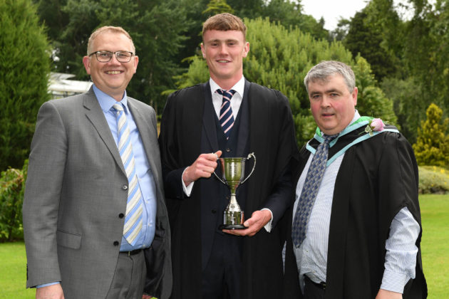 BIGGA winner Matthew Reid (Comber), was awarded the British and International Golf Greenkeepers Association (Northern Ireland) Award for the best Level 2 sportsturf management student, by John Young, of the British and International Golf Greenkeepers Association Young Greenkeepers Committee and Paul Campbell (Senior Lecturer Horticulture) at the Greenmount Campus Awards Ceremony.