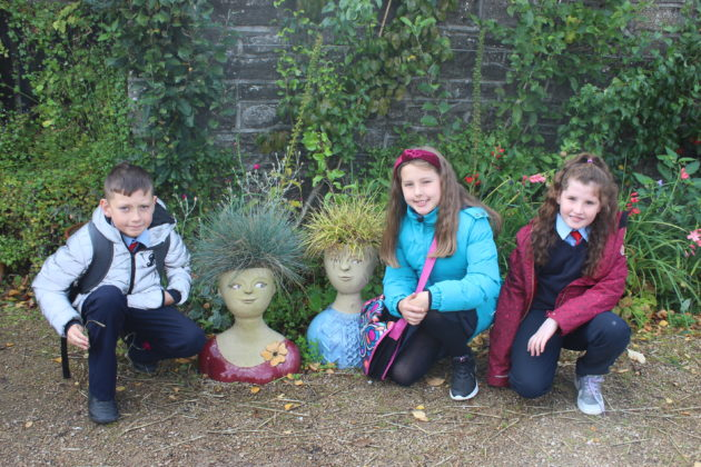 Pictured (L-R) are students Karl Cummins, Caitlin Dooley and Zoey Doyle who found some crazy haired gardeners on the grounds. The students got to explore the gardens, dig in to a planting workshop, and receive new seeds to bring back to their school. The school also received a sun bubble greenhouse for their own school garden as part of their 2019 Incredible Edibles prize. Visit www.incredibleedibles.ie to register today!